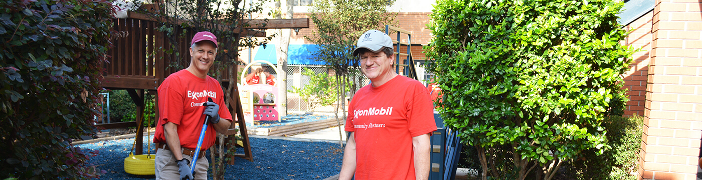 ExxonMobil volunteers beautifying our Transitional Housing Facility